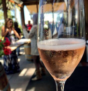 Glass of Wedding Cuvee at a tasting room