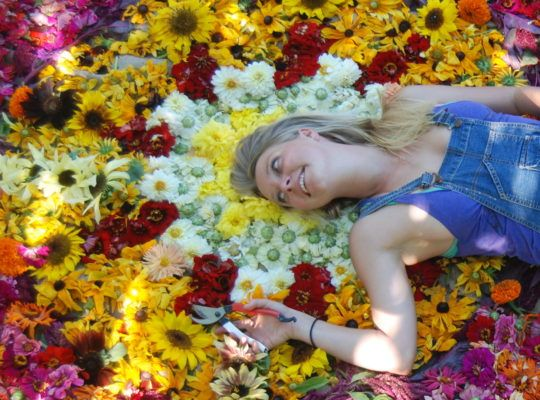 Lady laying in flowers
