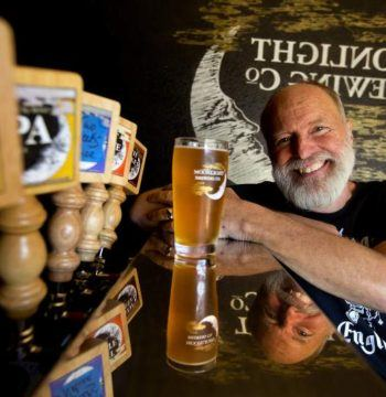 Man pouring craft beer